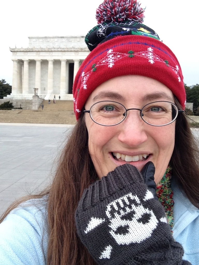 Andrea and her Christmas hat at the Lincoln Memorial on the fateful day of parting in January 2020.